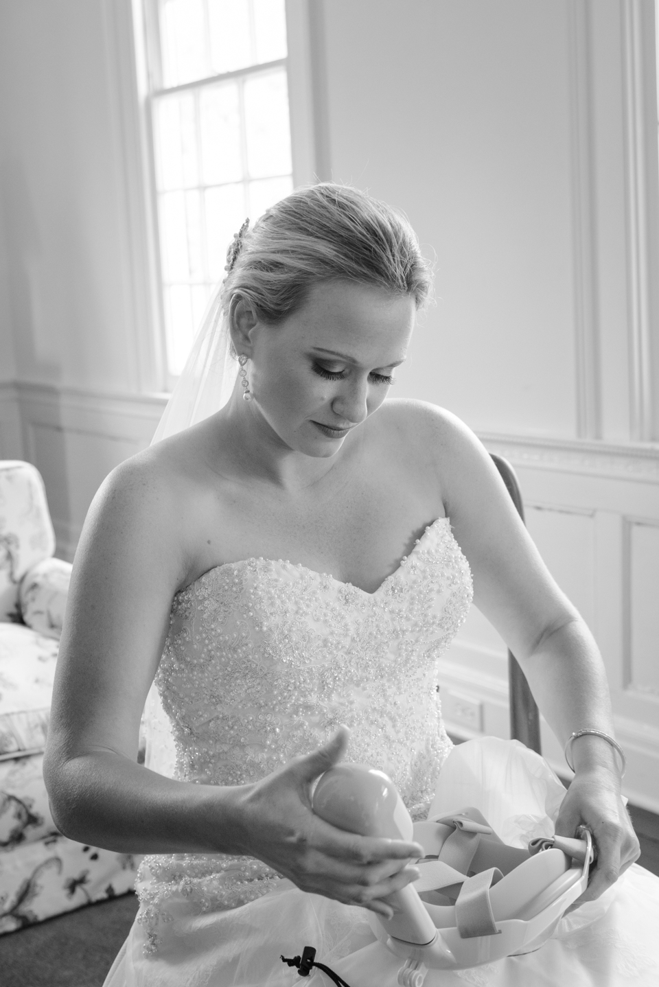 bride looks down at her wedding gift before her Litchfield Wedding