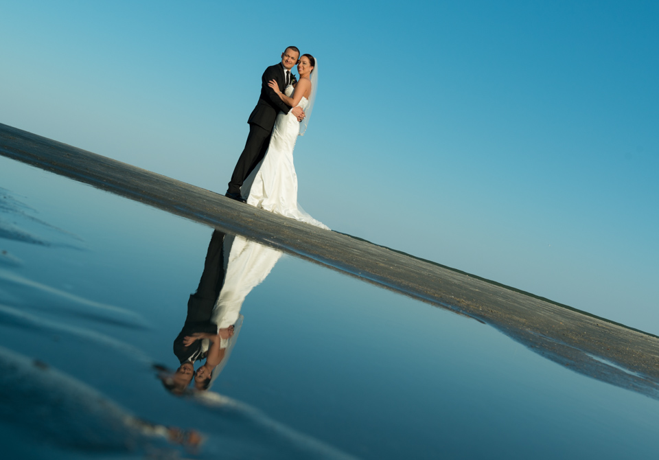 beach reflection, blue sky, happy couple, destination wedding photography, myrtle beach, conway, south carolina, best photographer, photojournalism, documentary, color images