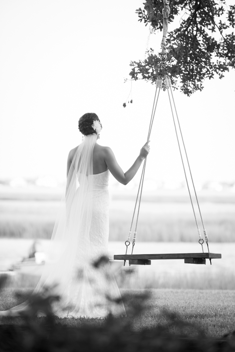 black and white bridal portrait by the marsh