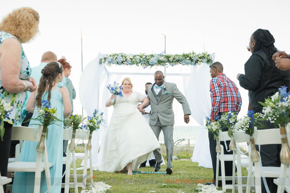 the bride and groom jump the broom before their Wedding Carriage Ride