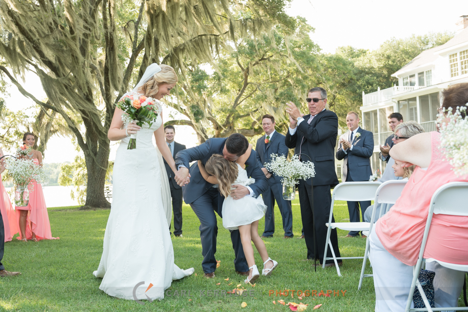 Groom hugging his daughter after wedding ceremony at Wachesaw Plantation