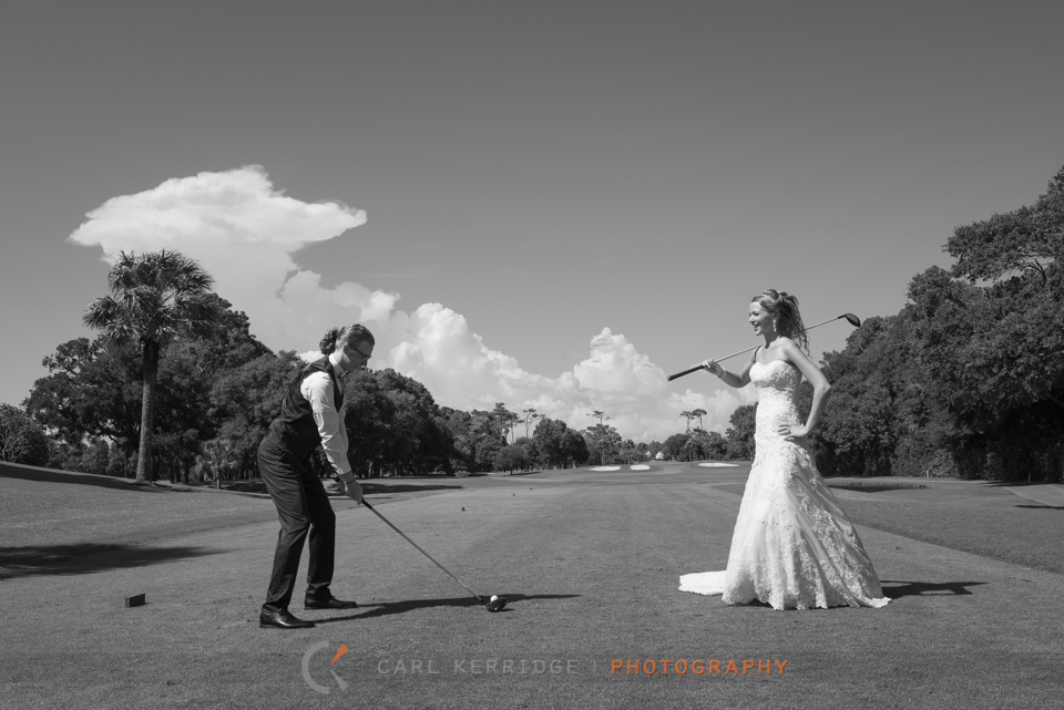 the bride watches as The groom tees off the green at the dunes club in myrtle beach