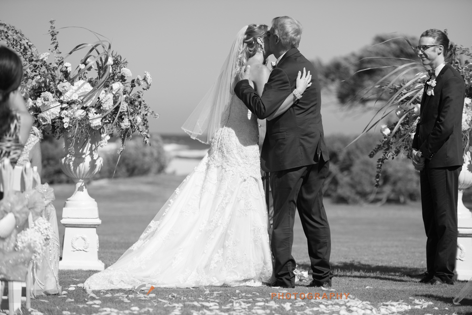 Dad kisses his daughter before he gives her away at this myrtle beach destination wedding