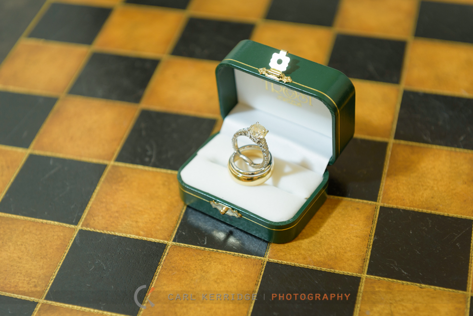 wedding rings balanced on a vintage chest board