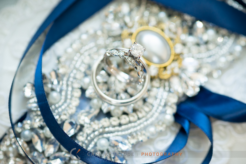 wedding details of the rings and bridal accessory