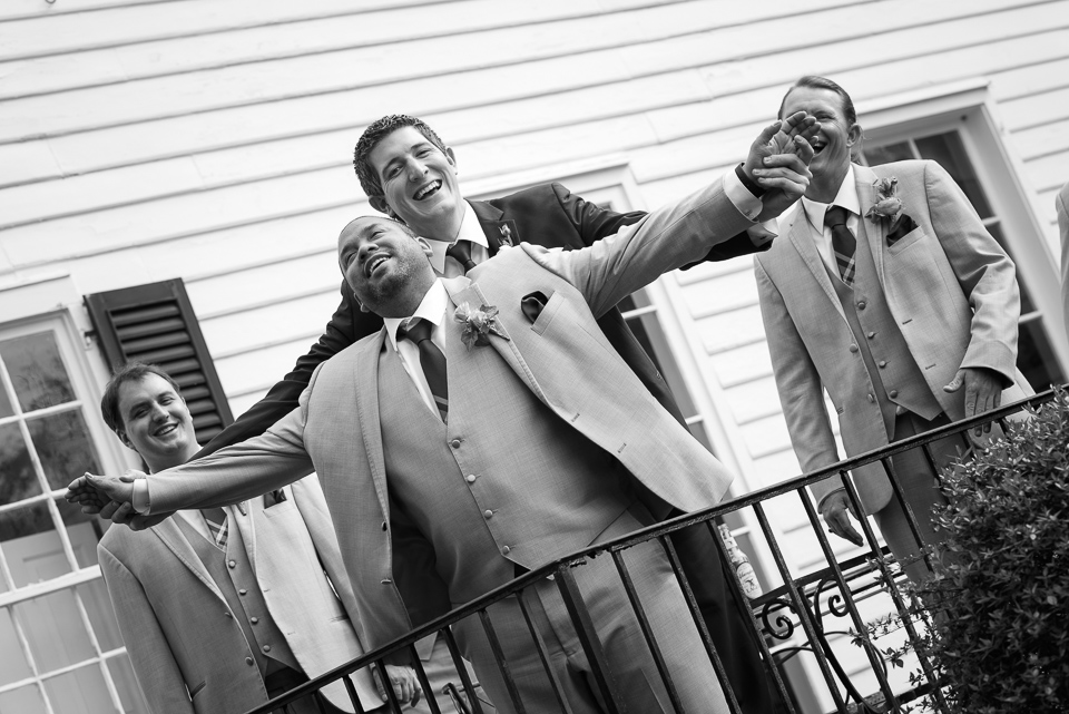 groom and groomsman pose for a silly candid during Litchfield Wedding portraits