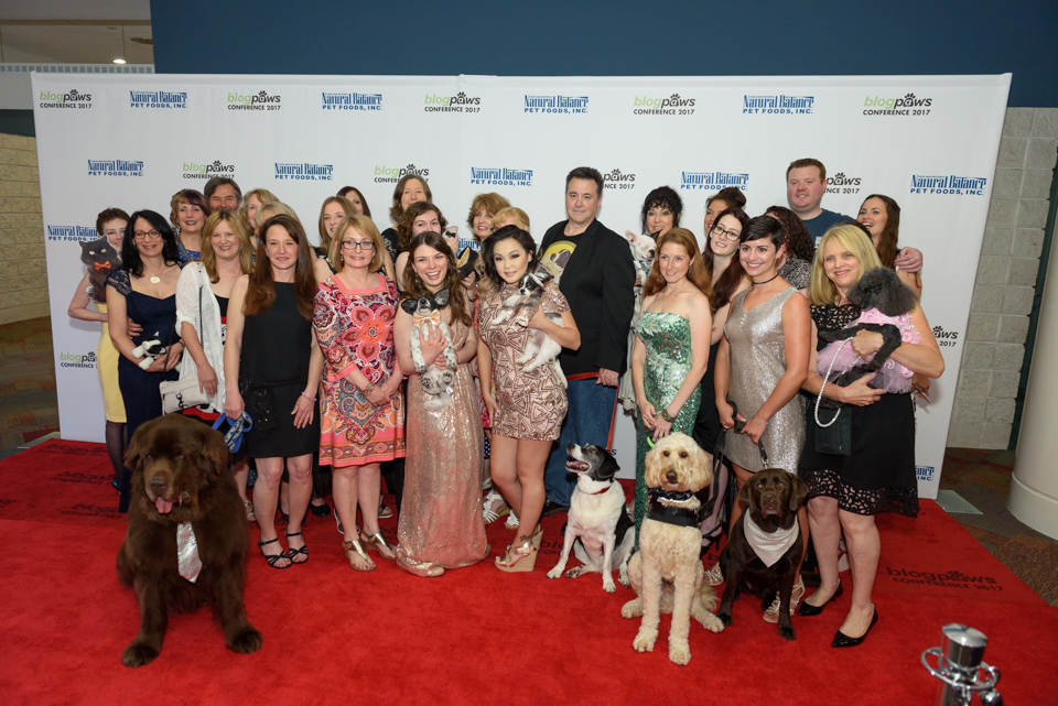 animal parents and fur-babies pose on the red carpet for a candid moment during the blogpaws conference